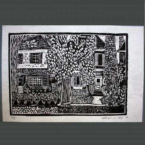 Linocut print of houses with trees