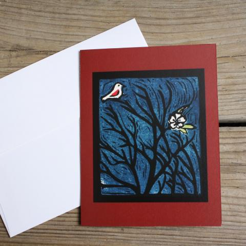 Card showing bird and flower in a bare tree, with envelope