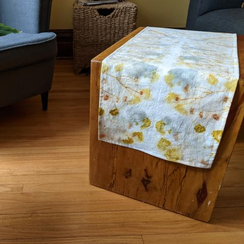 ecoprinted table runner on coffee table