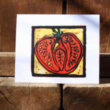 Card showing a sliced open tomato