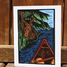 Card showing view of deer from canoe