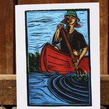 Card showing person in canoe