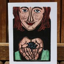 Card showing girl holding blueberries