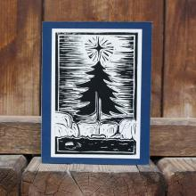 Card showing Christmas tree in the Canadian Shield