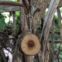 Keychain with chokecherry tree branch slice