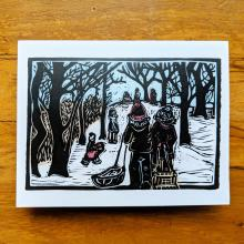 Card showing kids sledding