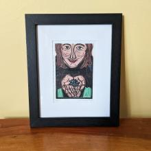 Framed print of girl with blueberries