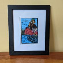 Framed Print of person in canoe