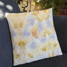 Ecoprinted cushion with leaf and flower pattern